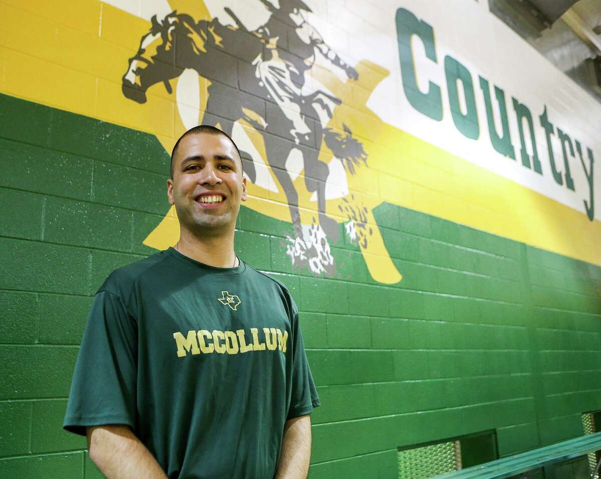 McCollum boys basketball coach Marcus Alvarado, shown in the school's gym in 2014, last month launched the Coaching Connections video series on YouTube.