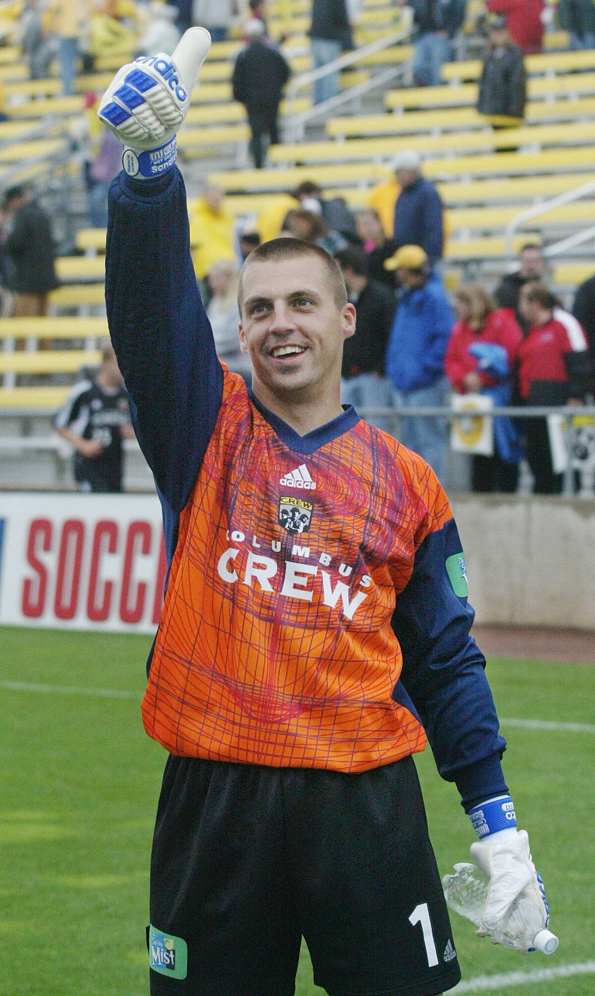(NCL CREW LAURON MERZ 15MAY04) Crew goal keeper Jon Busch, 1, acknowledges the fans after beating the New England Revolution at Crew Stadium, May 15, 2004. This was the 5th anniversary for the Crew Stadium. (Dispatch photo by Neal C. Lauron)