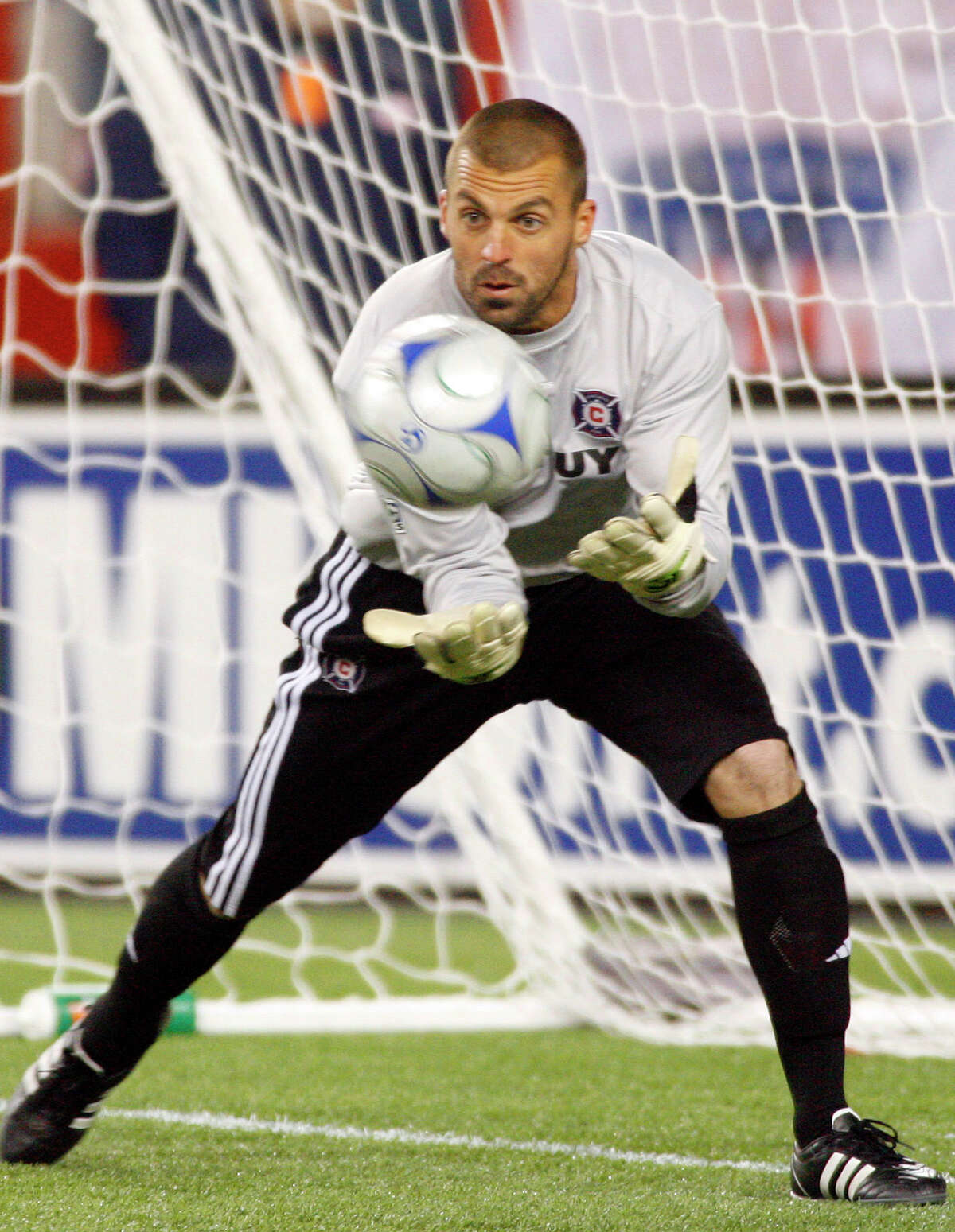 Chicago Fire goalkeeper Jon Busch makes a save against the New England Revolution during the second half of Game 1 of the MLS Eastern Conference soccer playoff series in Foxborough, Mass., Thursday, Oct. 30, 2008. The game ended tied at 0-0.