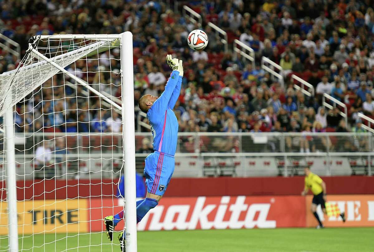SANTA CLARA, CA - AUGUST 02: Goalkeeper Jon Busch #18 of the San Jose Earthquakes makes a save against the Seattle Sounders FC during the second half of an MLS Soccer game at Levi's Stadium on August 2, 2014 in Santa Clara, California. The Earthquakes won the game 1-0. (Photo by Thearon W. Henderson/Getty Images) ORG XMIT: 462857373