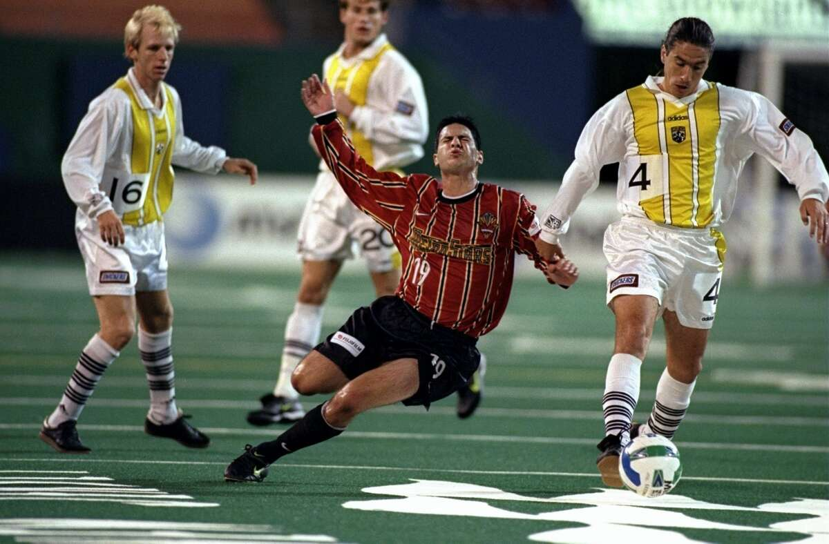 3 Oct 1998: Miles Joseph #19 of the New York/New Jersey Metrostars is held by Ricardo Iribarren #4 of the Columbus Crew as Rob Smith #16 of the Crew looks on during a first round MLS Playoff game at the Giants Stadium in East Rutherford, New Jersey. (Getty Images)