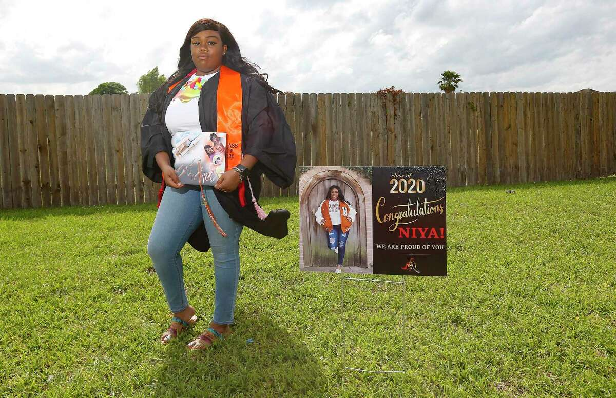 Anaiya Jackson, a senior at Scarborough High School, wears her graduation gown and holds the cap she dedicated to her grandmother who passed away in January in front of her Houston home on Tuesday, May 12, 2020.