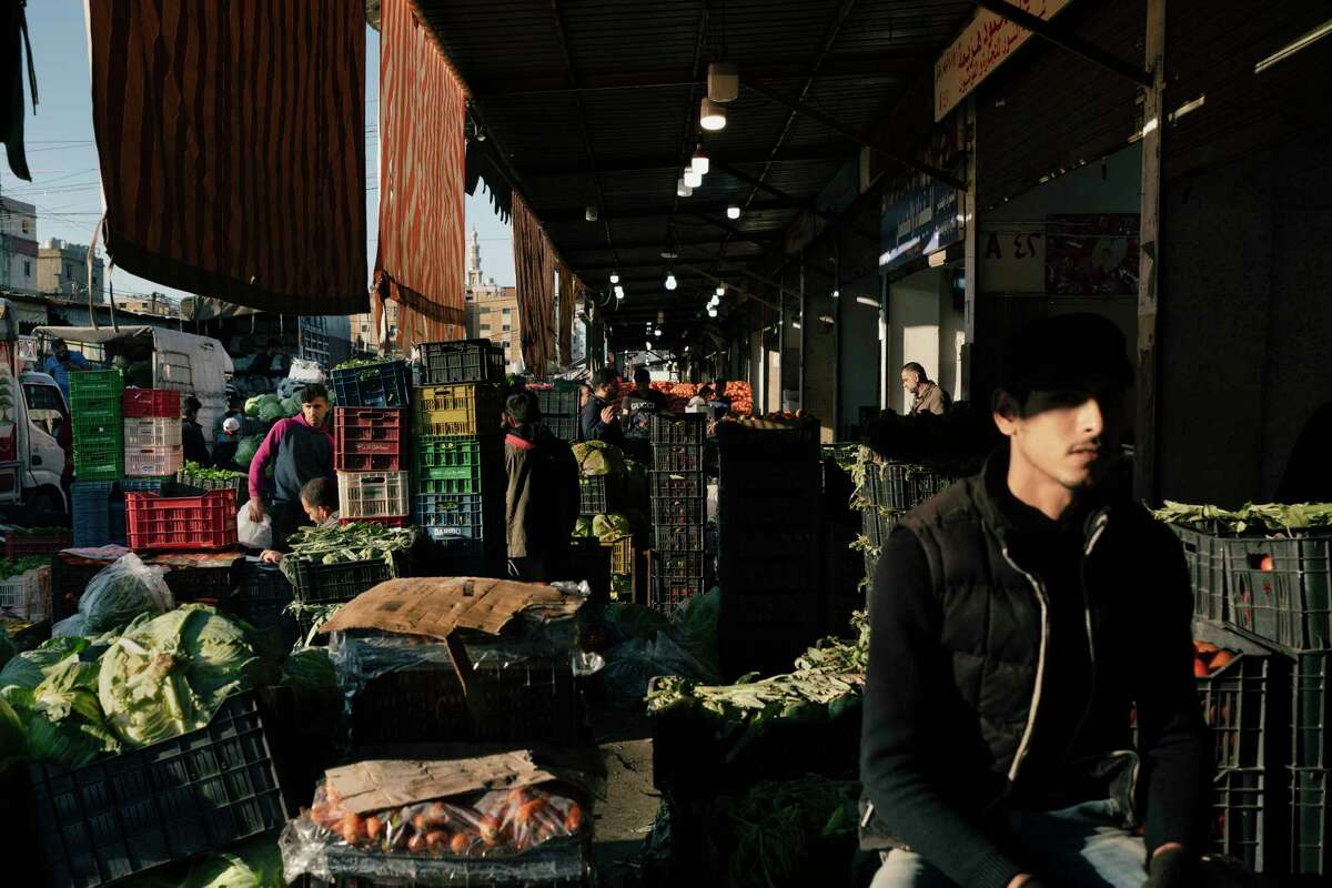 Traders at work in the main fruit and vegetable market Monday in Beirut. After an increase in the number of coronavirus cases in Lebanon, authorities have imposed a new four-day lockdown.