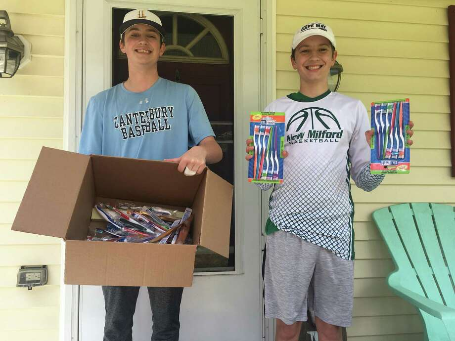 Brothers Jacob, left, and Ryder Gee of Gaylordsville recently collected more than 100 personal hygiene products to give to those in need during the pandemic. Photo: Courtesy Of Tara Gee / Danbury News Times Contributed