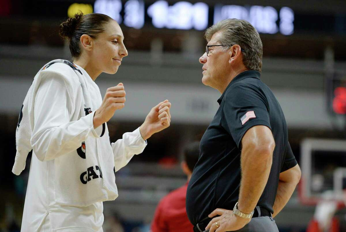 United States' Diana Taurasi, left, talks with head coach Geno Auriemma during the second half of a women's exhibition basketball game, Friday, July 29, 2016, in Bridgeport, Conn. (AP Photo/Jessica Hill)