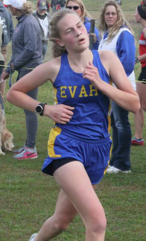 Evart's Sophia Scott gets close to the finish line of a cross country race last fall. (Herald Review file photo)