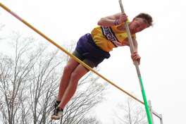 Xander Stockdale sails over the bar during a junior season that helped him win the opportunity to continue his vaulting career at Cornerstone University. (File photo)