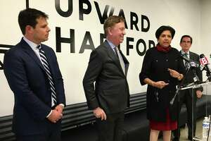Gov. Ned Lamont has brought in The Boston Consulting Group to help with reopening the state. Lamont, center, is shown with his economic team in 2019. From left, David Lehman, Commissioner of the state Department of Economic and Community Development; Lamont; Indra Nooyi, retired chairman and CEO of PepsiCo; and Jim Smith, former CEO of Webster Bank. Nooyi and Smith are co-chairs of AdvancCT, a quasi-public development agency; and Nooyi is also co-chair of the reopening advisory committee.