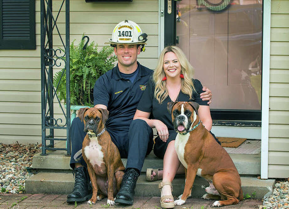 Ahlemeyer and his girlfriend, Kristen Schmidt, and their dogs in a recent family photo. Photo: Courtesy Of Dinnius Photography