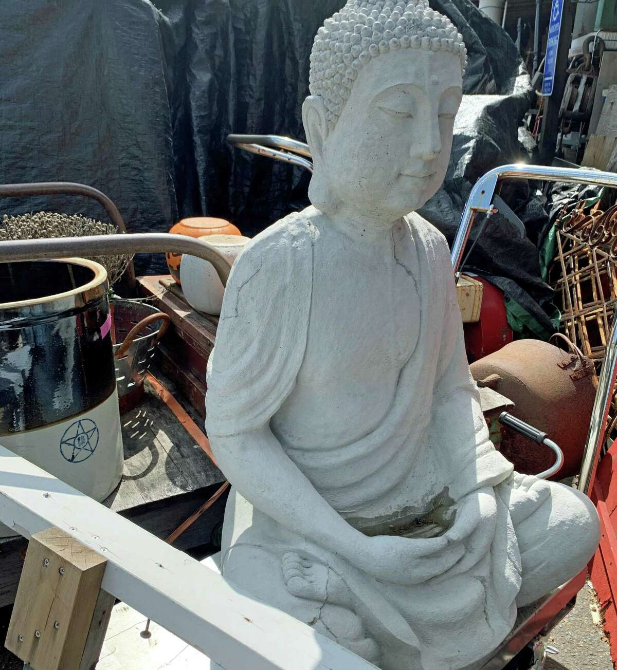 A concrete Buddha at the Picking Pot Thriftique Store. The entire store is up for auction.