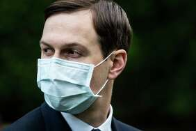 Jared Kushner, wearing a face mask, listens as President Trump delivers remarks during a press briefing on testing with administration officials in the Rose Garden at the White House on May 11, 2020 in Washington..