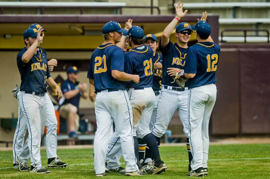 Midland High players celebrate their 4-1 victory over Holland West Ottawa in a June 12, 2018 Division 1 quarterfinal. Photo: Daily News File Photo