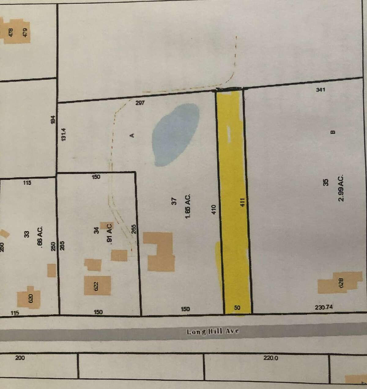 The 0 Long Hill Avenue parcel is described as a rectangular strip of land, 50 feet wide, 411 feet in length, and located in a R-1 residential zone. The parcel the city hopes to sell is shaded.