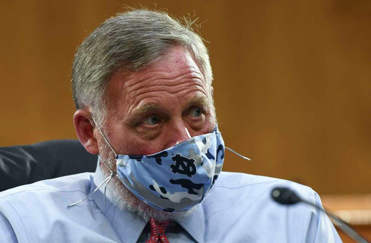 Sen. Richard Burr, R-N.C., opts for a beard and Tar Heels mask.