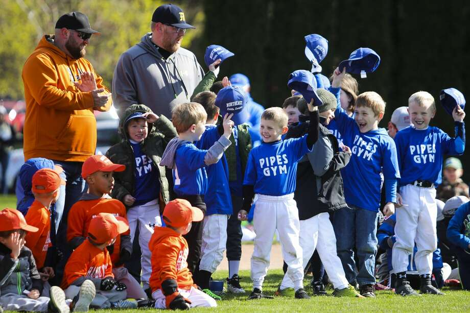 Players tip their caps during Northeast Little League's opening day ceremonies on April 27, 2019 at Plymouth Park. Photo: Daily News File Photo
