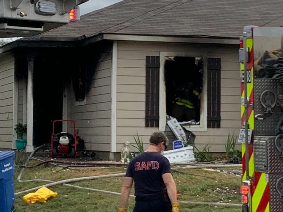 One person was hospitalized after a house caught fire on the Far East Side Wednesday, according to the San Antonio Fire Department. Photo: Mark Dunphy