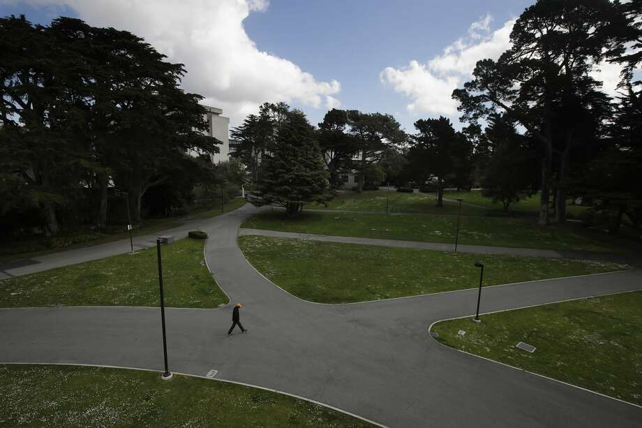 A man walks alone on a path on the San Francisco State University campus in San Francisco, Thursday, March 19, 2020. Cal State Universities will stay closed through the fall semester. Photo: Jeff Chiu/AP / Copyright 2020 The Associated Press. All rights reserved