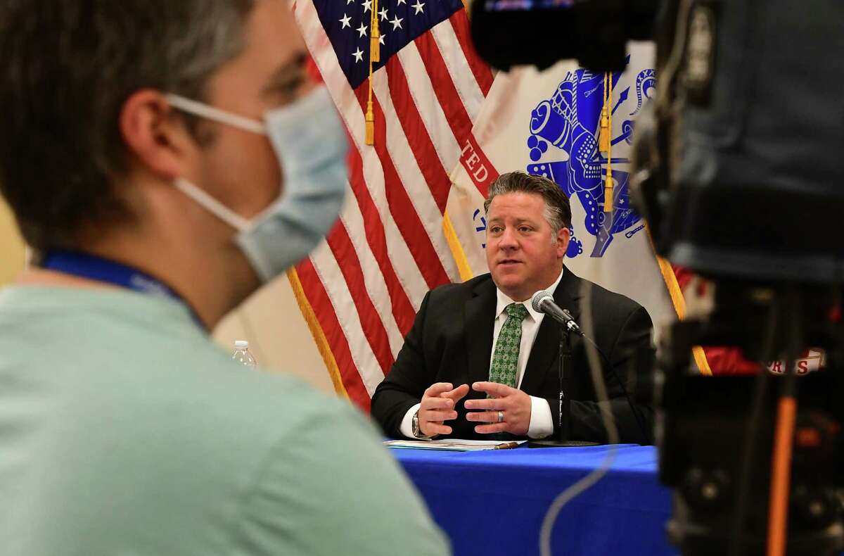 Albany County Executive Dan McCoy, right, speaks at his daily press conference to discuss the latest COVID-19 information on Wednesday, May 13, 2020 in Albany, N.Y. (Lori Van Buren/Times Union)