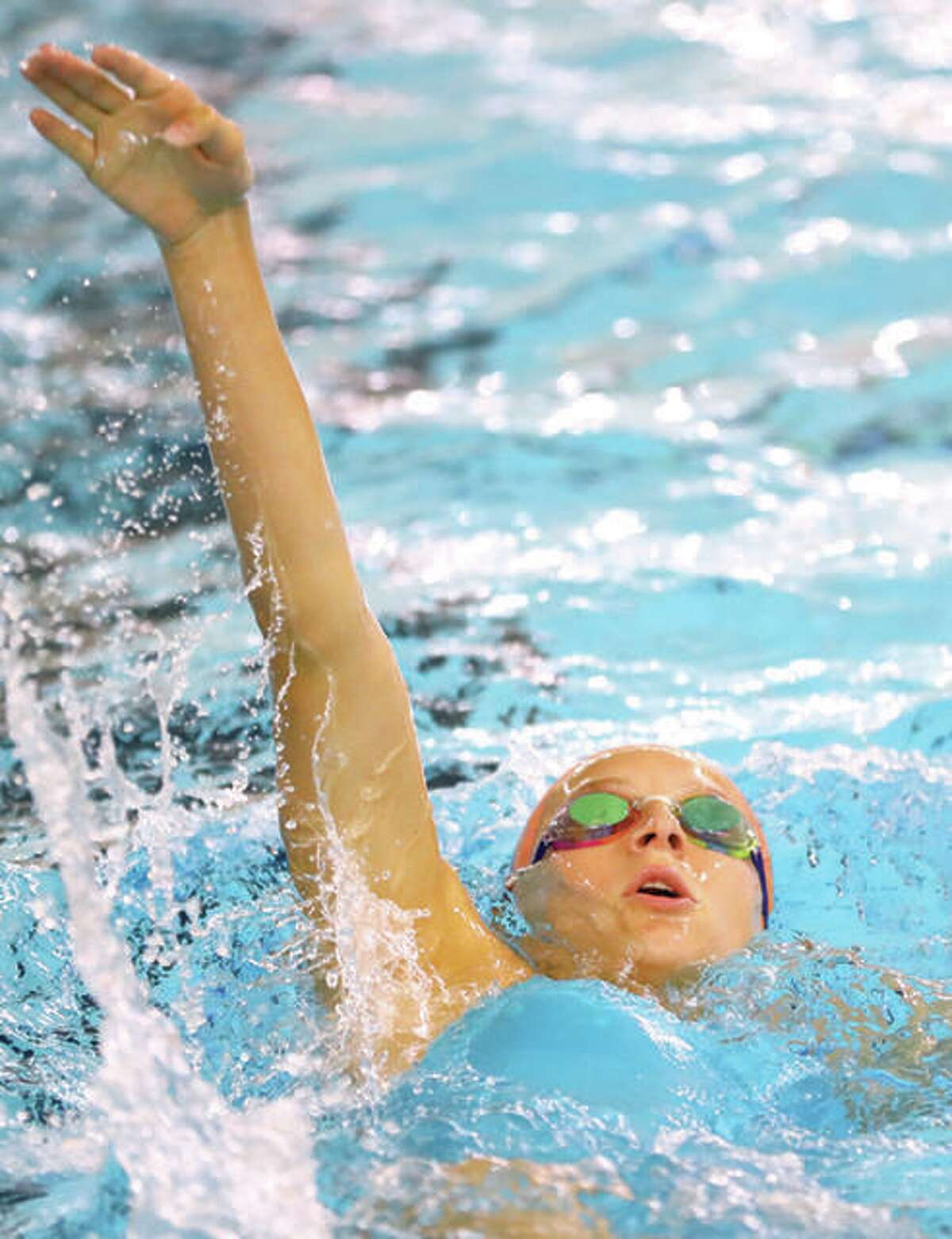 Edwardsville's Bailey Grinter competes in the 100-yard backstroke during a meet. Grinter was a state champion in the event.