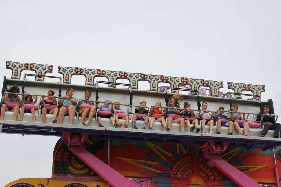Kids enjoy one of the rides at the Tuscola County Fair in 2017. This year's fair, which would have been the 139th annual, has been canceled due to coronavirus concerns. Photo: (Tribune File Photo)