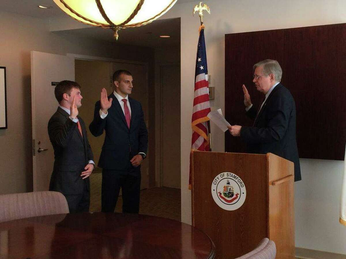 Officer James Webb (left) at his swearing in as a police officer in Summer 2015.