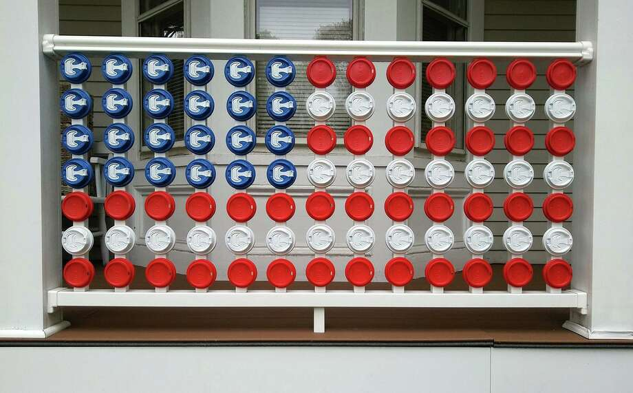 Darien artist Robert Carley has created a series in tribute to artist Jasper Johns of Sharon. Above, a coffee cup lid flag. Photo: Robert Carley / Contributed Photo