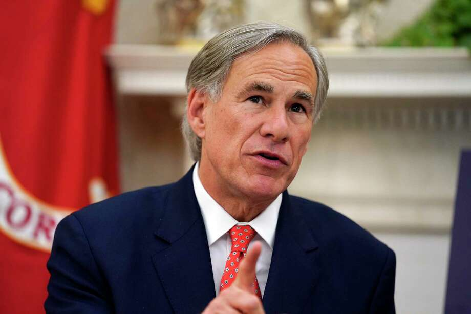 Texas Gov. Greg Abbott speaks with President Donald Trump during a meeting about the coronavirus response in the Oval Office of the White House, Thursday, May 7, 2020, in Washington. (AP Photo/Evan Vucci) Photo: Evan Vucci, STF / Associated Press / Copyright 2020 The Associated Press. All rights reserved
