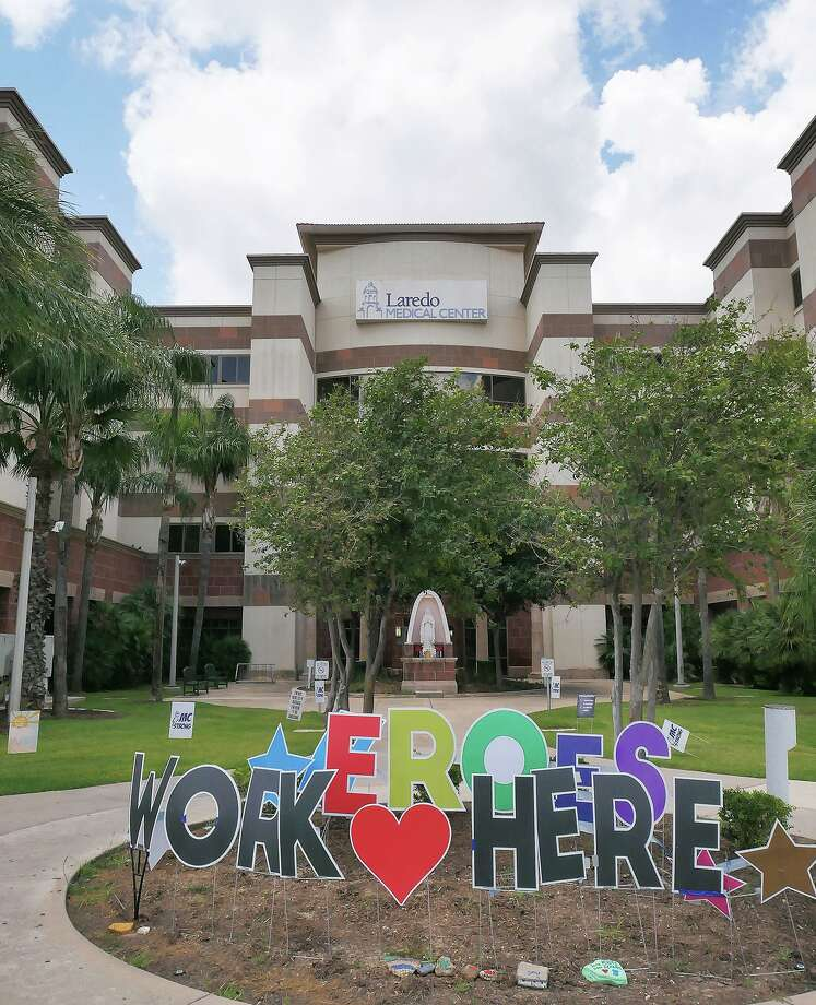 A Heroes Work Here sign is pictured outside of Laredo Medical Center on May 11 as health care workers battle the COVID-19 pandemic inside. In the face of a once-in-a-lifetime global crisis, frontline health care workers have been vital to the community, as all of them share in receiving LMT's 2020 Laredoans of the Year award. Photo: Cuate Santos / Laredo Morning Times File / Laredo Morning Times