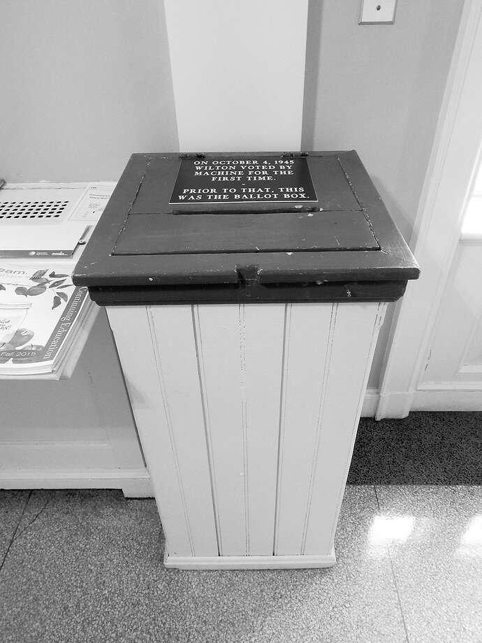 What's old is new again. This is the ballot box Wilton voters used until machine voting began in 1945. Secretary of the State Denise Merrill has ordered a box be secured to a sidewalk in each town to receive absentee ballots this year. Photo: Kendra Baker / Hearst CT Media / Wilton Bulletin