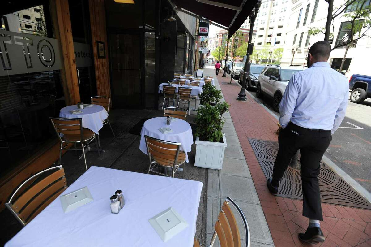 A run of eateries on Bank Street in Stamford, Conn., in May 2018. Under a May 2020 executive order, Gov. Ned Lamont is allowing restaurants to offer outdoor table service during the coronavirus pandemic that has shuttered dining rooms, provided municipalities ensure six feet of leeway, including through road closures or other means.