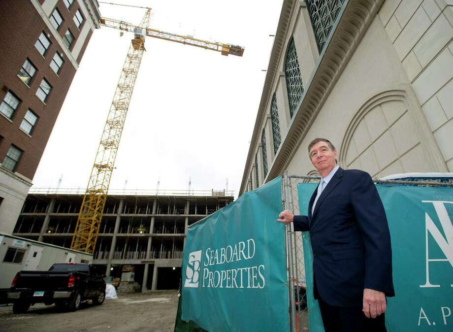 John DiMenna, President of Seaboard Properties, poses for a photo in front of the company's project on Atlantic Street in Stamford, Conn., on Tuesday, November 25, 2014. Photo: File / Hearst Connecticut Media / Stamford Advocate