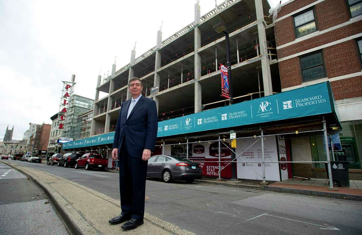 John DiMenna, President of Seaboard Properties, poses for a photo in front of the company's project on Atlantic Street in Stamford, Conn., on Tuesday, November 25, 2014.