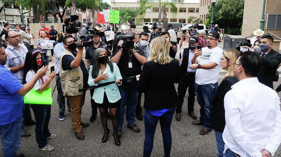 Media and protestors gather outside Laredo City Hall, Wednesday, May 13, 2020, during a freedom rally protesting business closures amid the COVID-19 coronavirus pandemic. The rally featured Dallas business owner Shelley Luthor, Laredo business owners Brenda Stephanie Mata and Ana Isabel Castro-Garcia. Photo: Danny Zaragoza/Laredo Morning Times