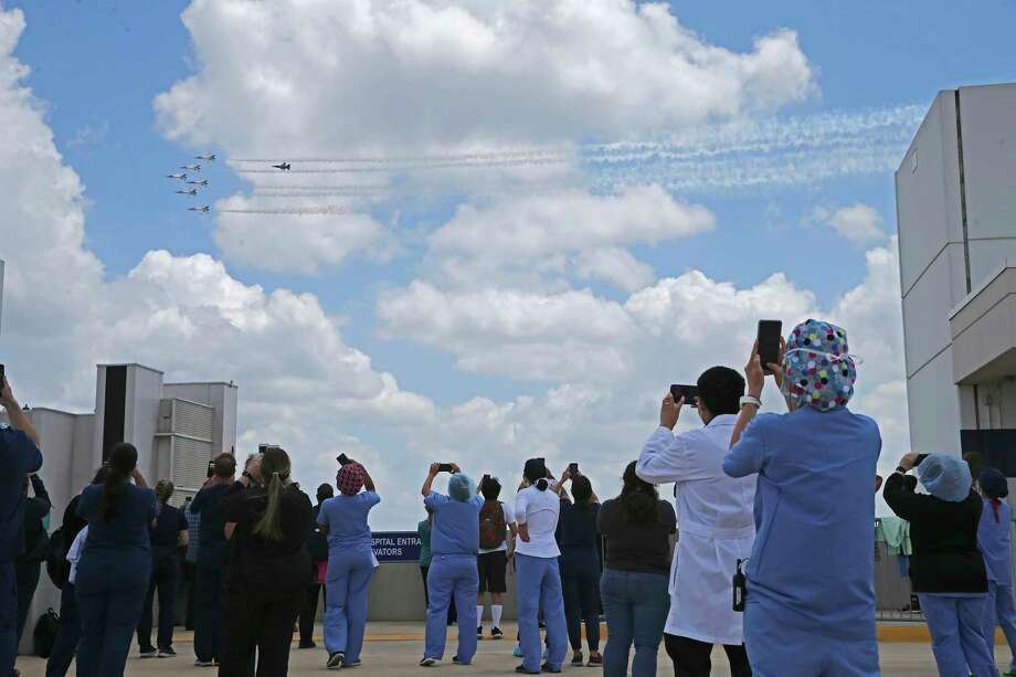 The Thunderbirds fly over the Medical Center area as staff and family members watch from a top of a garage at Methodist Hospital, Wednesday, May 13, 2020. Photo: Jerry Lara, San Antonio Express-News / **MANDATORY CREDIT FOR PHOTOG AND SAN ANTONIO EXPRESS-NEWS/NO SALES/MAGS OUT/TV   © 2019 San Antonio Express-News