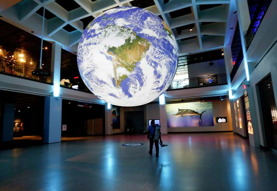 """Gaia - Earth by Luke Jerram"" is on view at the Houston Museum of Natural Science May 15-June 30. Photo: Elizabeth Conley, Houston Chronicle / Staff Photographer / © 2020 Houston Chronicle"
