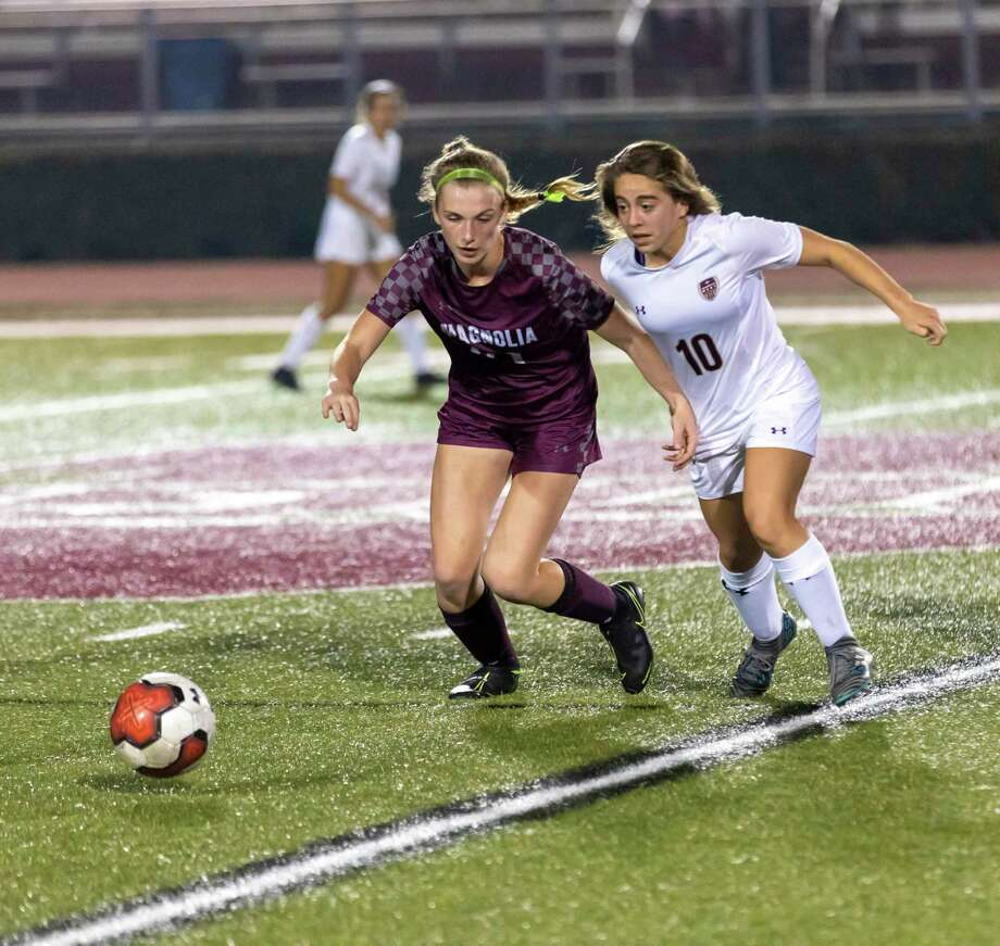 Magnolia soccer player Katie Clark (21) blocks Magnolia West soccer player Grace Matocha (10) from taking control of hte ball in a 19-5A match in Magnolia, Tuesday, Feb. 4 , 2020. Photo: Gustavo Huerta, Houston Chronicle / Staff Photographer / Houston Chronicle