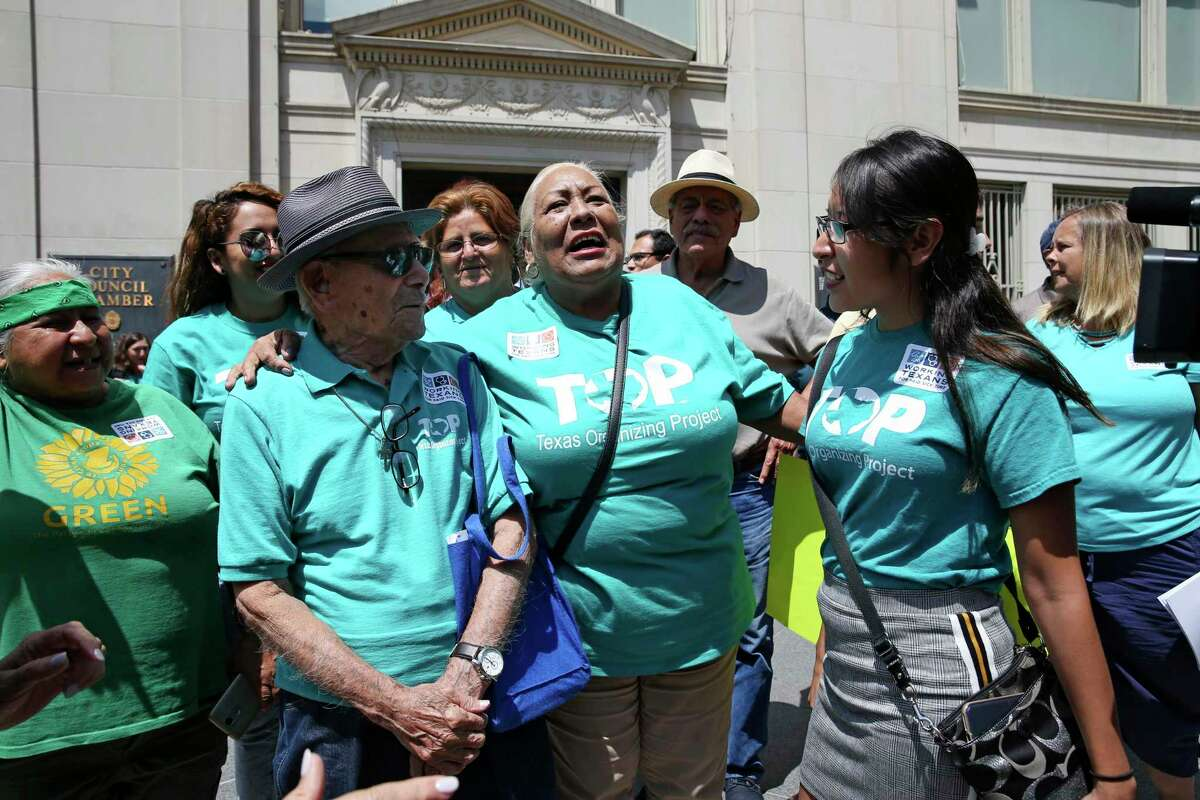 Texas Organizing Project members celebrated in 2018 after the San Antonio City Council passed its paid-sick-leave ordinance. Now, TOP is seeking a grace period for tenants who are struggling to pay bills during the pandemic.
