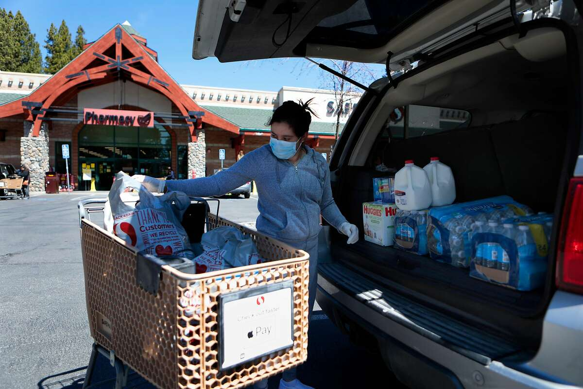 Lupita Herrera, who was born and raised in Tahoe Vista, Ca. loads her vehicle with food supplies from the local Safeway in Kings Beach, Ca., on Thurs. April 23, 2020.