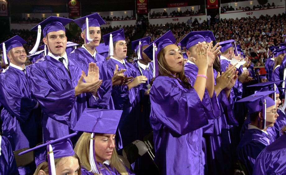 Following Roberto Pena's valedictorial speech, his fellow Humble High School graduates give him a standing ovation Sunday, May 25, 2003, at the University of Houston. (Photo by Brett Coomer/Special to the Chronicle) Photo: BRETT COOMER, FREELANCE / SPECIAL TO THE CHRONICLE / FREELANCE
