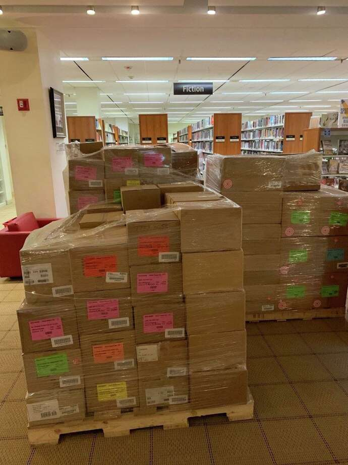 The books — lots of them — were delivered to the Ferguson Library. They are now packaged for distribution to students in Stamford on Friday. Photo: Contributed /