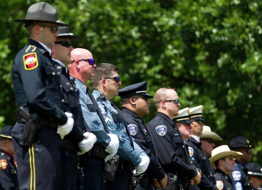 Members of law enforcement from various agencies are seen during a National Police Officers Memorial Ceremony at Heritage Plaza, Thursday, May 16, 2019, in Conroe. Photo: Jason Fochtman, Houston Chronicle / Staff Photographer / © 2019 Houston Chronicle