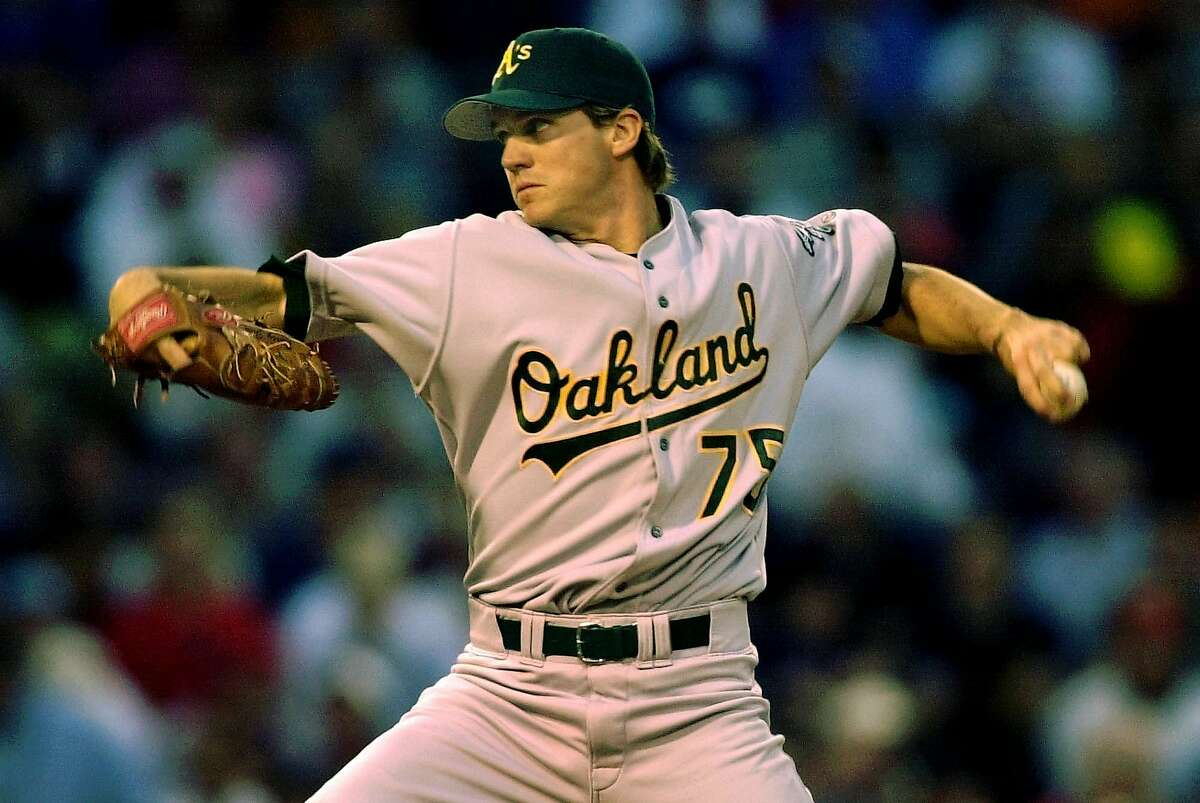 Oakland Athletics starting pitcher Barry Zito delivers a throw in the third inning against the Boston Red Sox at Fenway Park in Boston, Thursday May 16, 2002. (AP Photo/Charles Krupa)