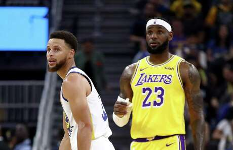 Warriors guard Stephen Curry, left, and Lakers forward LeBron James were among reported participants in a Monday conference call.