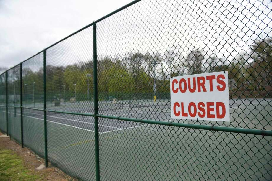 Greenwich tennis courts will soon have the closed signs taken down. On Friday town courts will be open up for singles play, but not doubles. Photo: Tyler Sizemore / Hearst Connecticut Media / Greenwich Time
