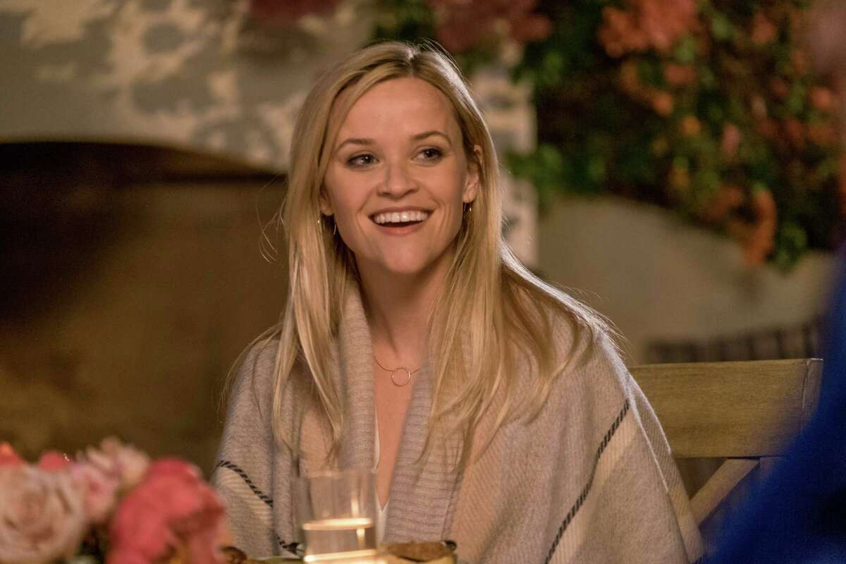 Alice (Reese Witherspoon) is a single mom living in Los Angeles whose life changes unexpectedly when she allows three young men to move in with her. MUST CREDIT: Open Road Films
