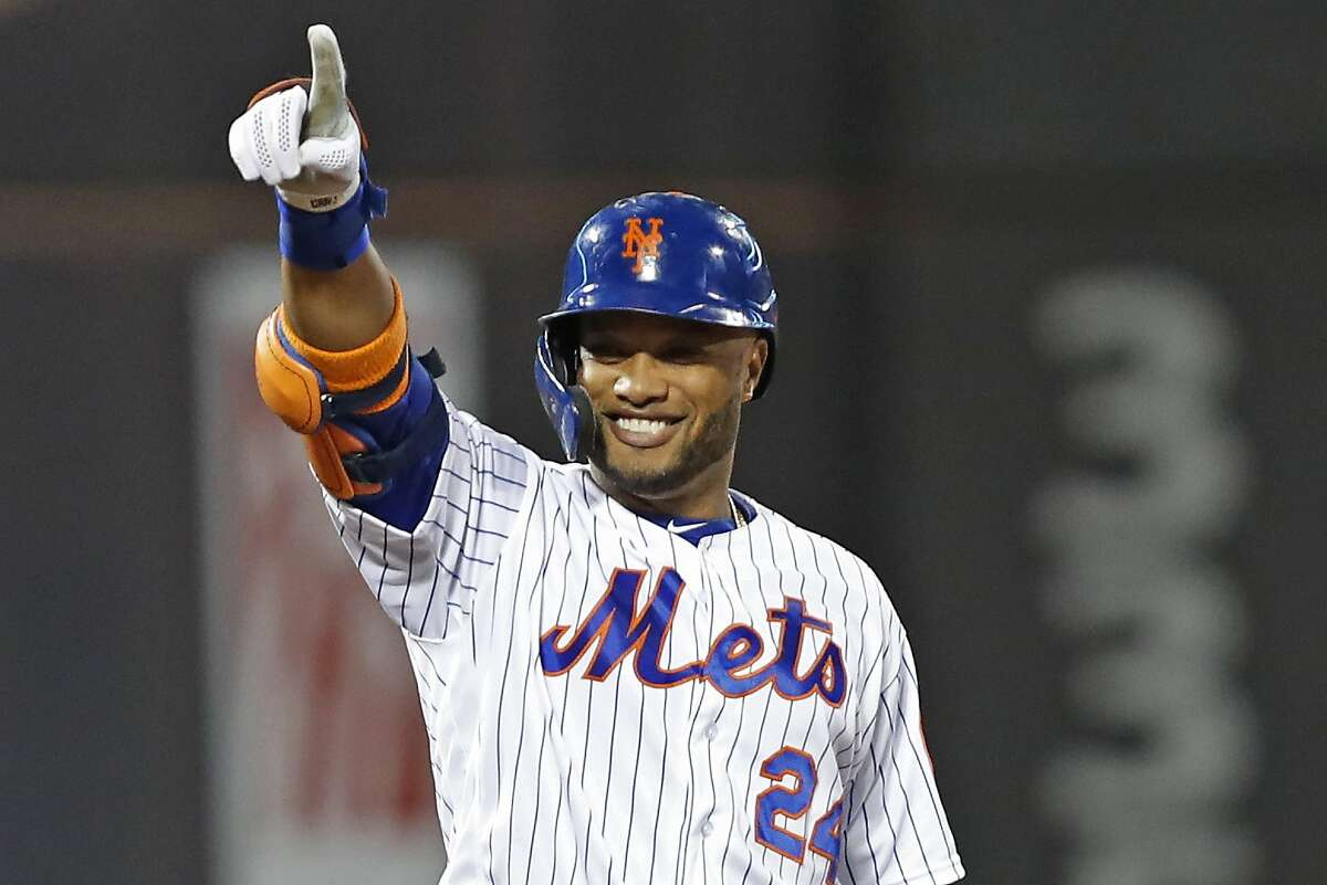 New York Mets Robinson Cano gestures back toward the Mets' dugout of a baseball game, Wednesday, Sept. 25, 2019, in New York. (AP Photo/Kathy Willens)