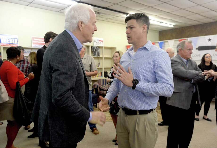 "Senator John Cornyn talks with supporters, including Luke Bird, during a campaign rally urging Texans to ""Saddle Up 'n Vote"" at the Jefferson County Republican Party Headquarters in Port Neches Monday. Cornyn was joined by several other candidates and politicians at the event as candidates from both parties make their final push for Southeast Texas voters leading up to Super Tuesday. Photo taken Monday, March 2, 2020 Kim Brent/The Enterprise Photo: Kim Brent / The Enterprise / BEN"