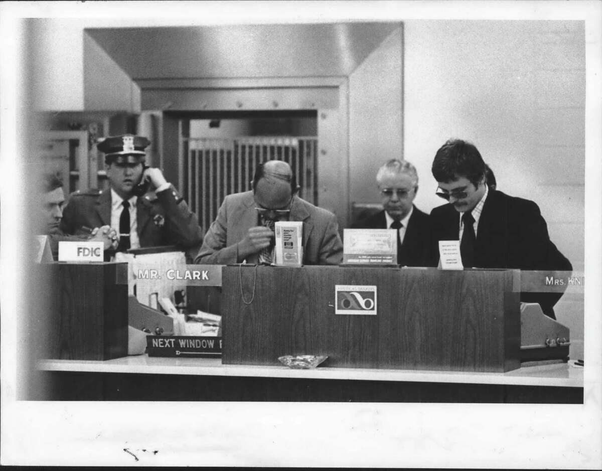 State Bank of Albany, Loudonville, New York branch - moments after robbery - interior shot with FBI, Colonie Police Department, and bank officials. May 14, 1974 (Skip Dickstein/Times Union Archive)