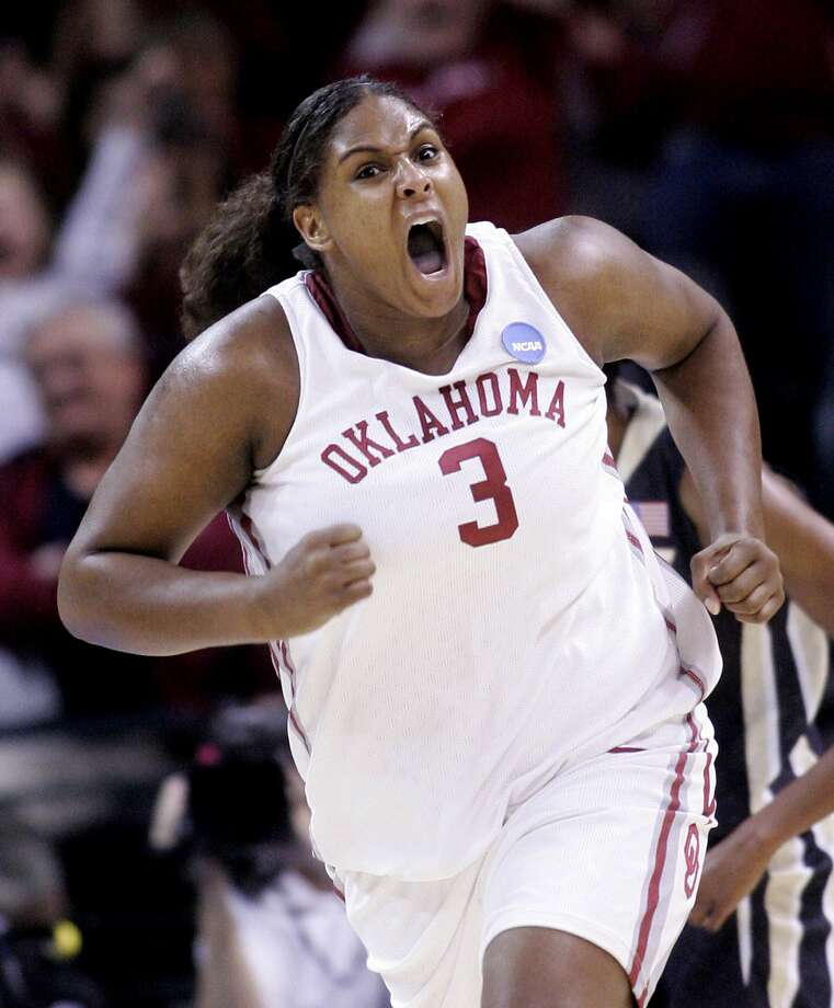 FILE - In this Tuesday, March 31, 2009, file photo, Oklahoma's Courtney Paris (3) reacts after scoring against Purdue in the second half of a women's NCAA tournament regional championship college basketball game in Oklahoma City. Paris, who left Oklahoma with 20 NCAA Division I records, is returning to Oklahoma as an assistant coach. (AP Photo/Sue Ogrocki, File) Photo: Sue Ogrocki / Associated Press