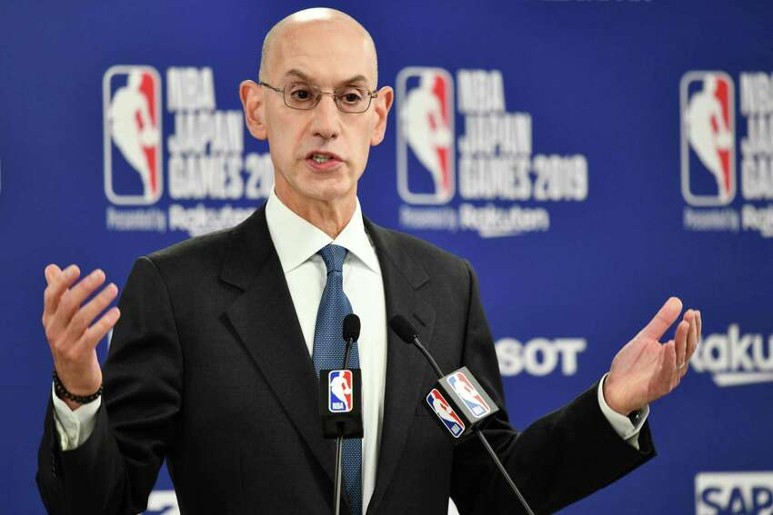 (FILES) In this file photo taken on October 08, 2019 NBA Commissioer Adam Silver speaks during a press conference prior to the NBA Japan Games 2019 between the Toronto Raptors and Houston Rockets in Saitama - NBA commissioner Adam Silver is ready to accept the consequences for defending freedom of speech, even if supporting those values means losing the riches that Chinese business partnerships have brought the league. (Photo by Kazuhiro NOGI / AFP) (Photo by KAZUHIRO NOGI/AFP via Getty Images)